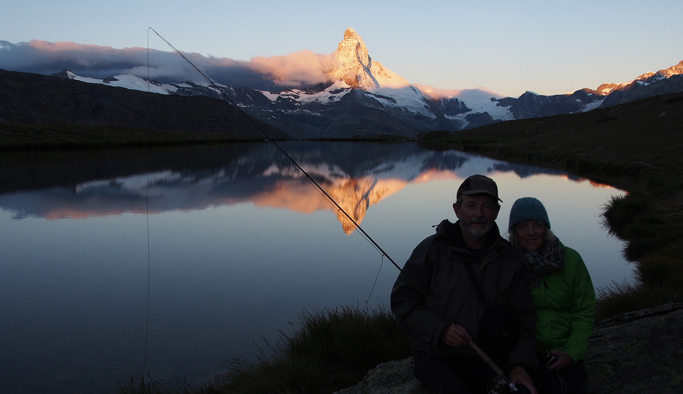 Fly Fishing in Switzerland, with the sun rising on the Matterhorn