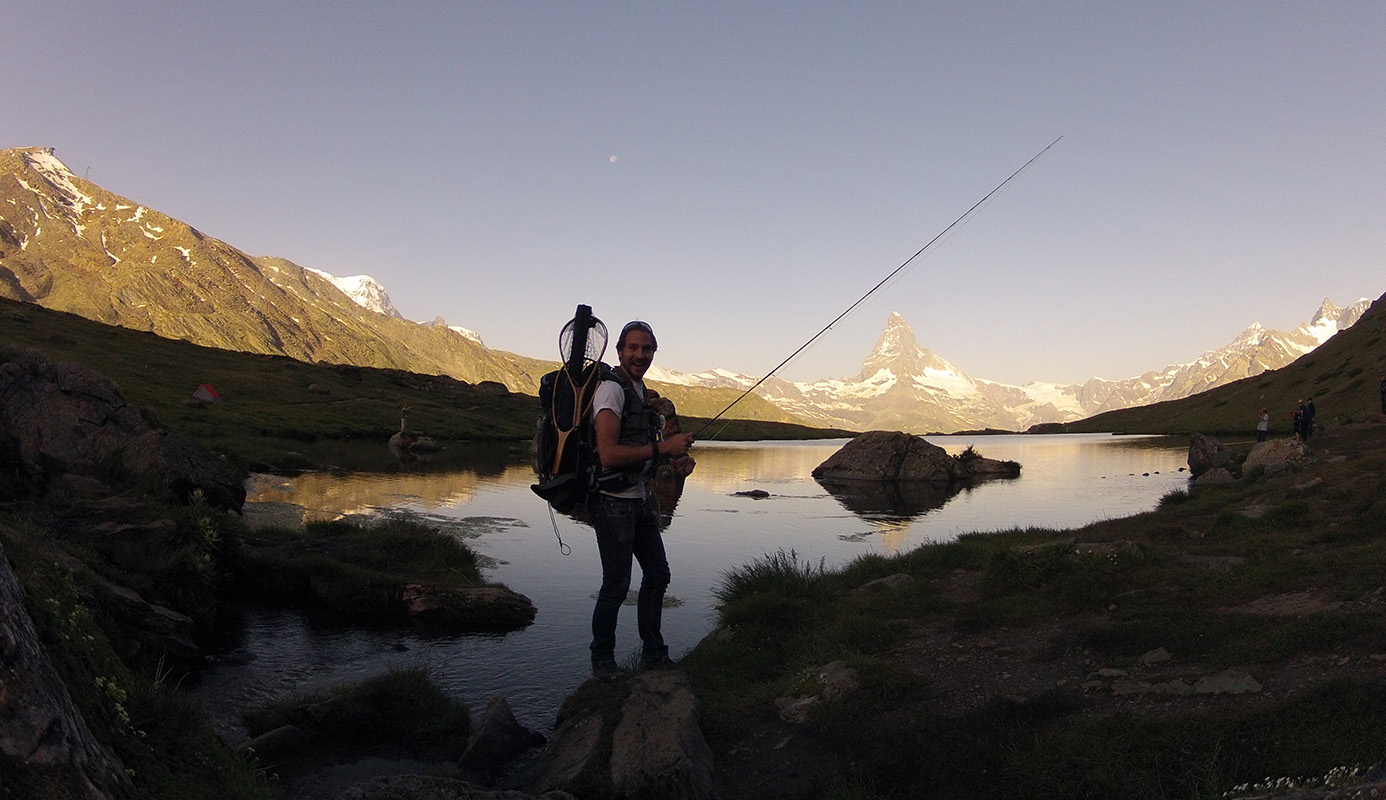 Fly Fishing in Switzerland, hiking into position with the sunrise on the Matterhorn